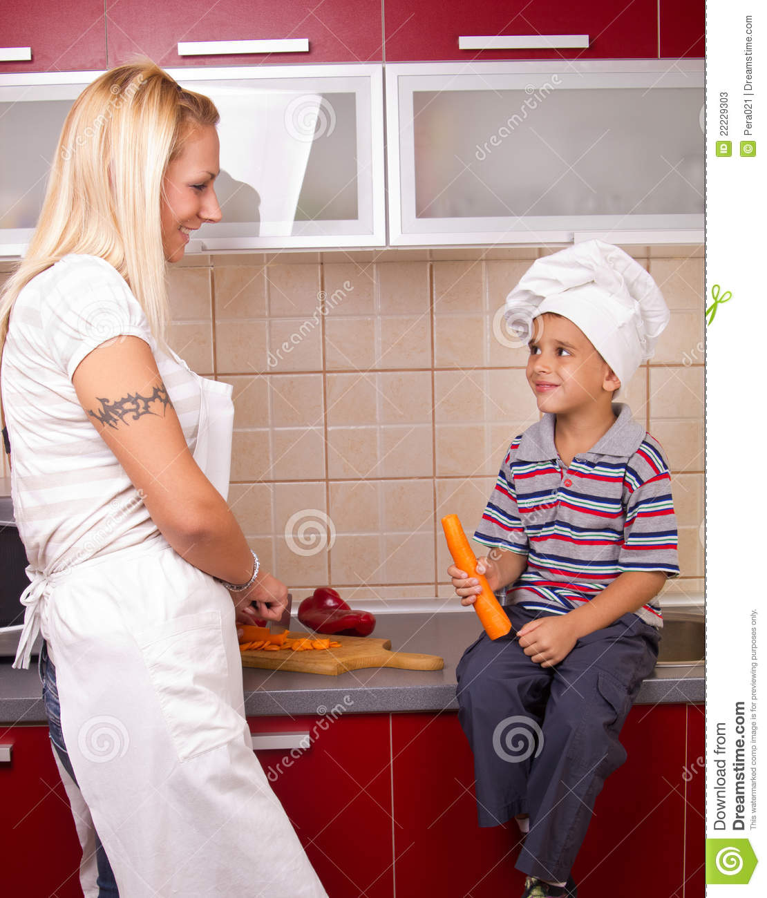 Mother And Son In The Kitchen Stock Photos Image 22229303