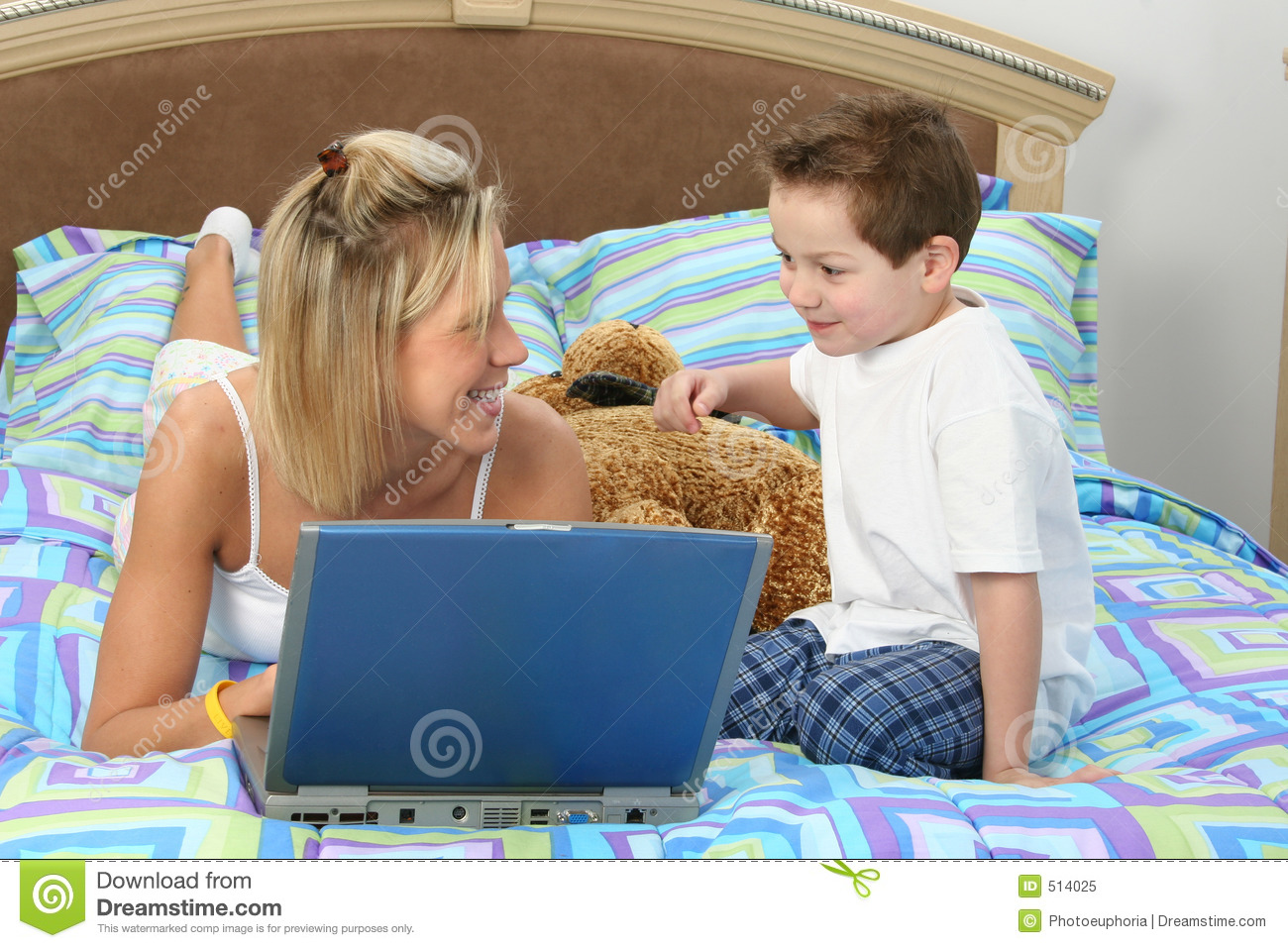 mother and son with laptop in bed royalty free stock photo image 514025. Black Bedroom Furniture Sets. Home Design Ideas