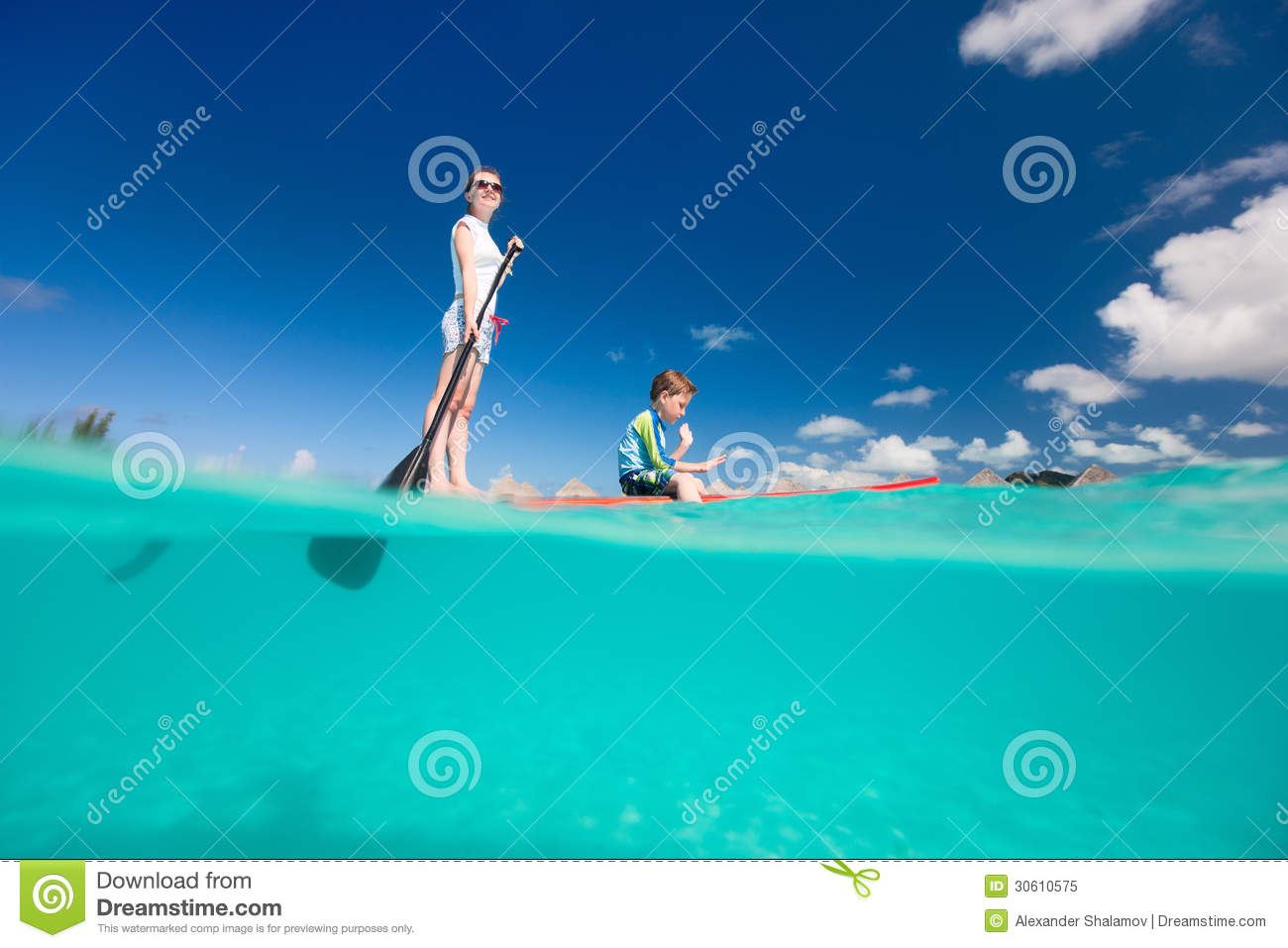 Mother and son paddling