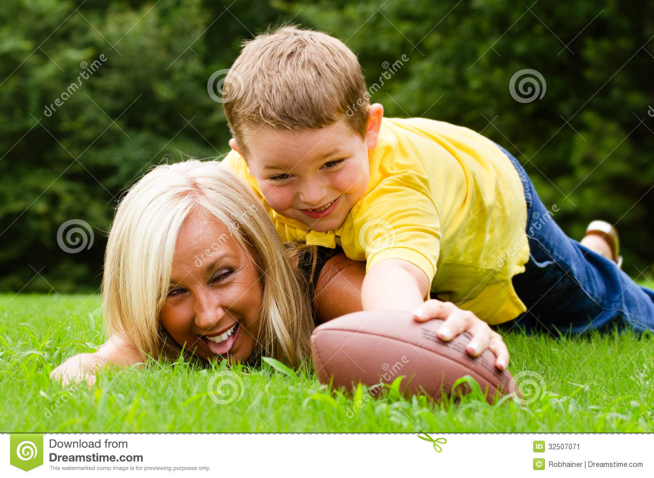 mother and son playing football outdoors stock image image 32507071. Black Bedroom Furniture Sets. Home Design Ideas