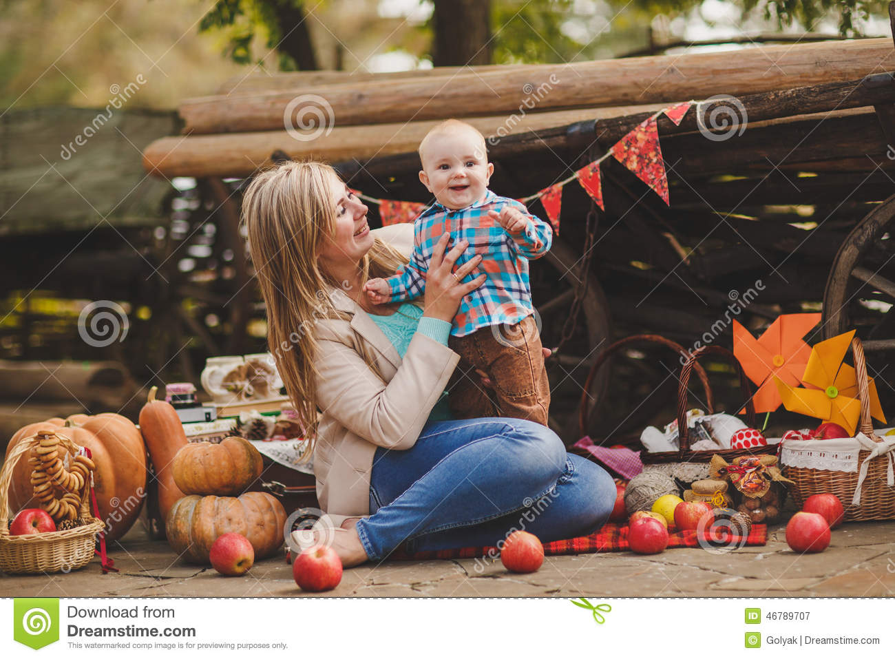 Mother And Son Playing In The Yard In The Village Stock