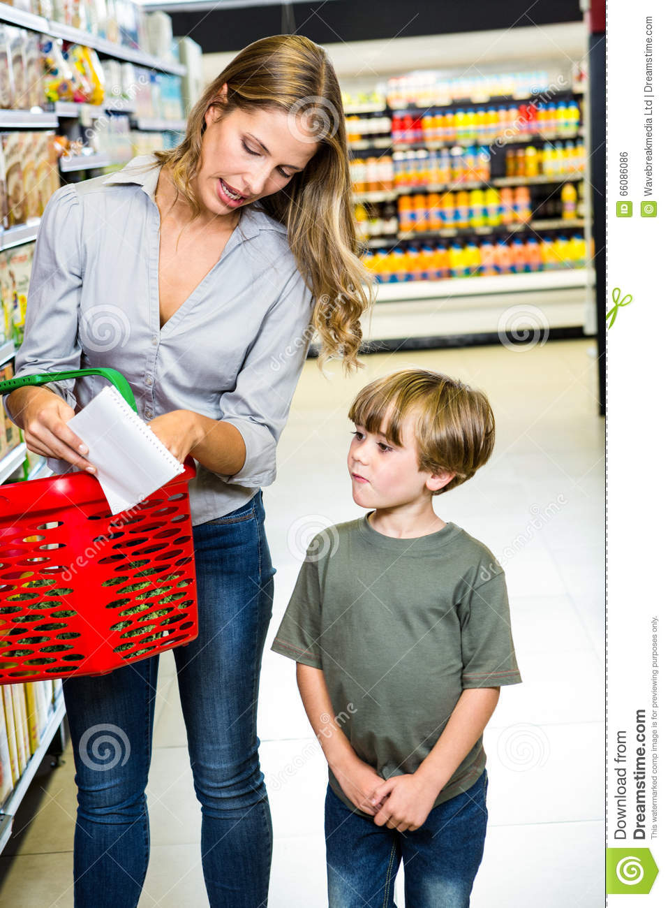 mother and son reading shopping list stock photo image of female