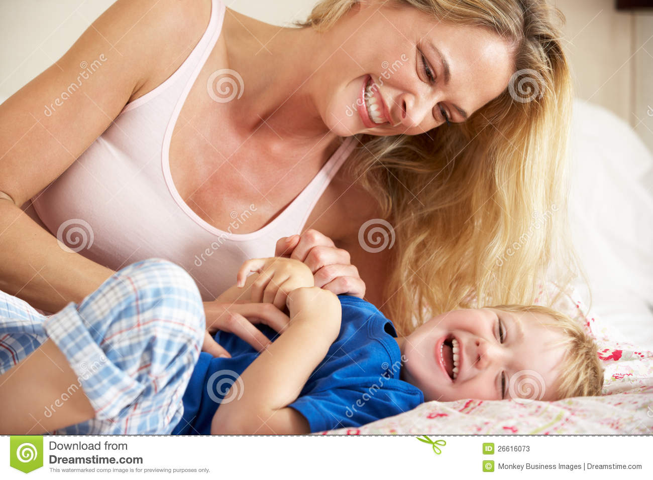 mother and son relaxing together in bed stock photos image 26616073. Black Bedroom Furniture Sets. Home Design Ideas