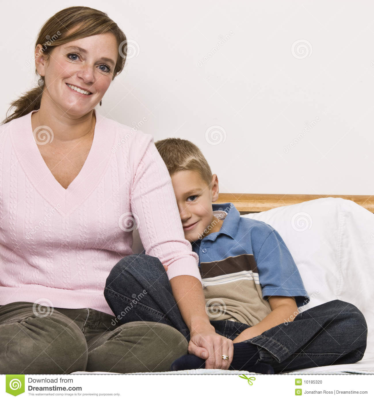 mother and son sitting on bed stock photo image 10185320. Black Bedroom Furniture Sets. Home Design Ideas