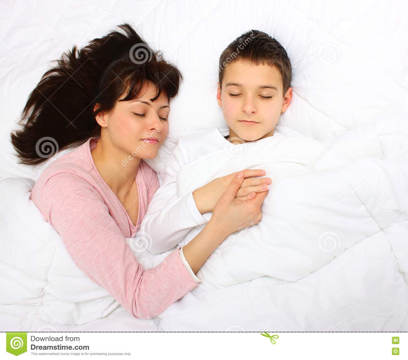 Son fists sleeping mother