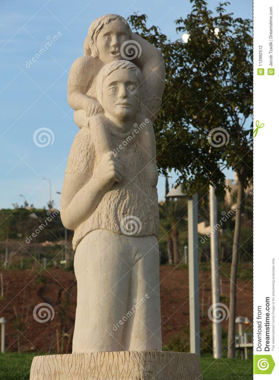 Mother and son statue