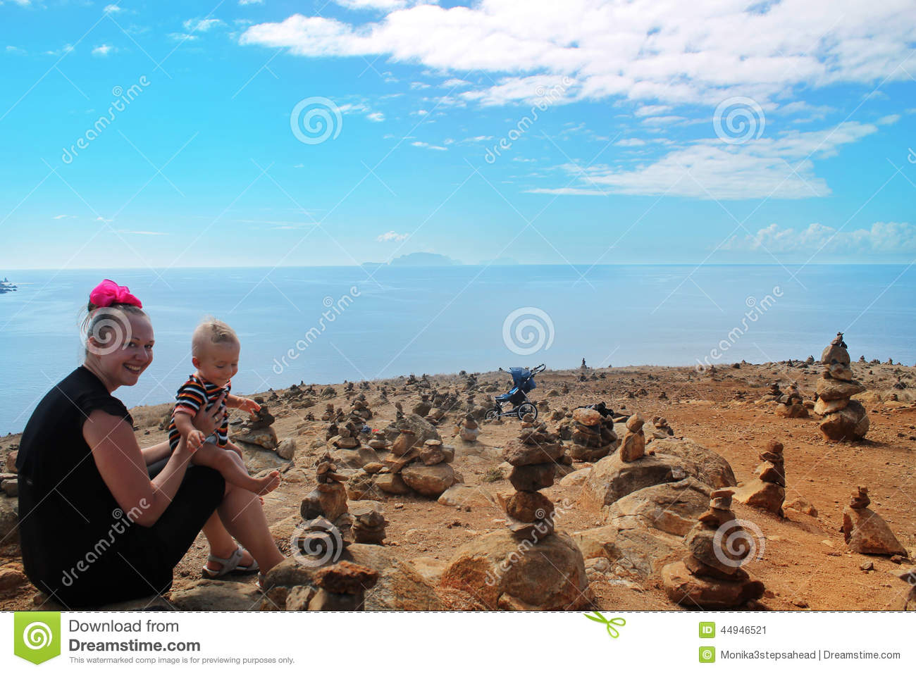 Mother and son on stone desert