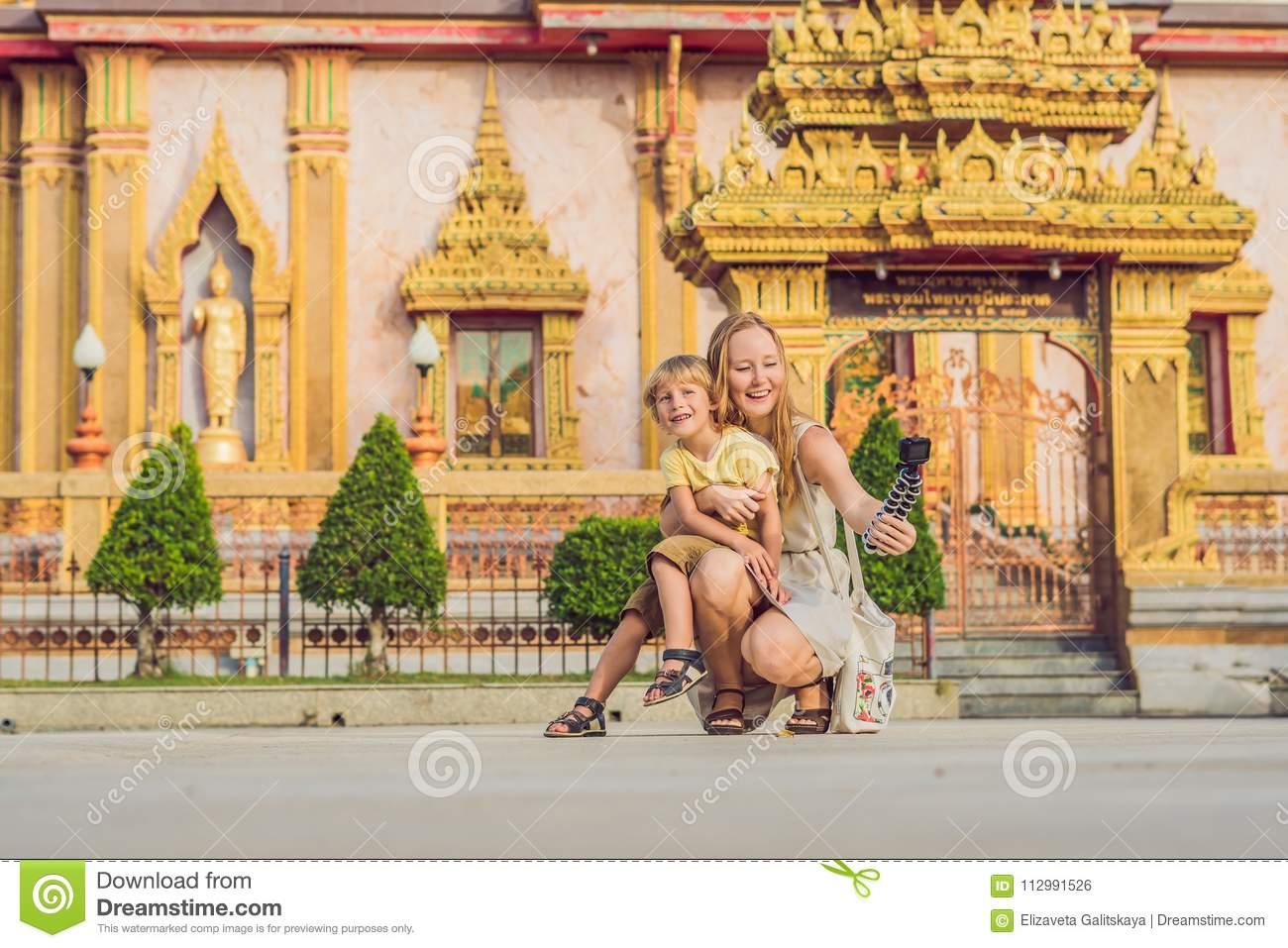Mother and son tourists look at Wat Chalong is the most important temple of Phuket