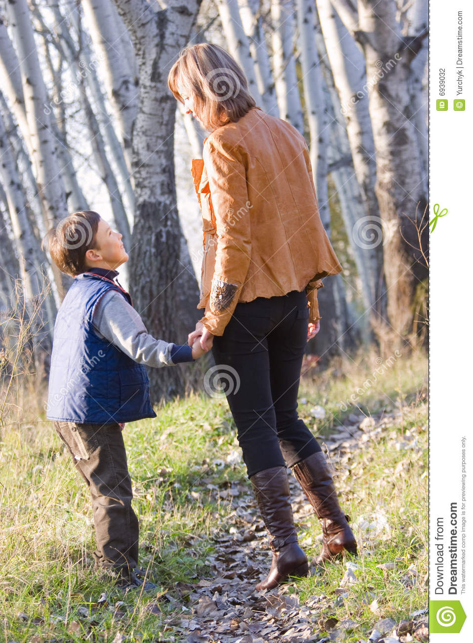 mother and son walking through forest stock photography