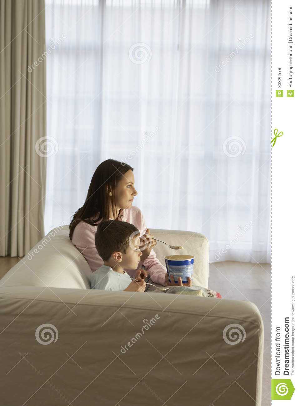 Mother And Son Watching Tv Royalty Free Stock Image