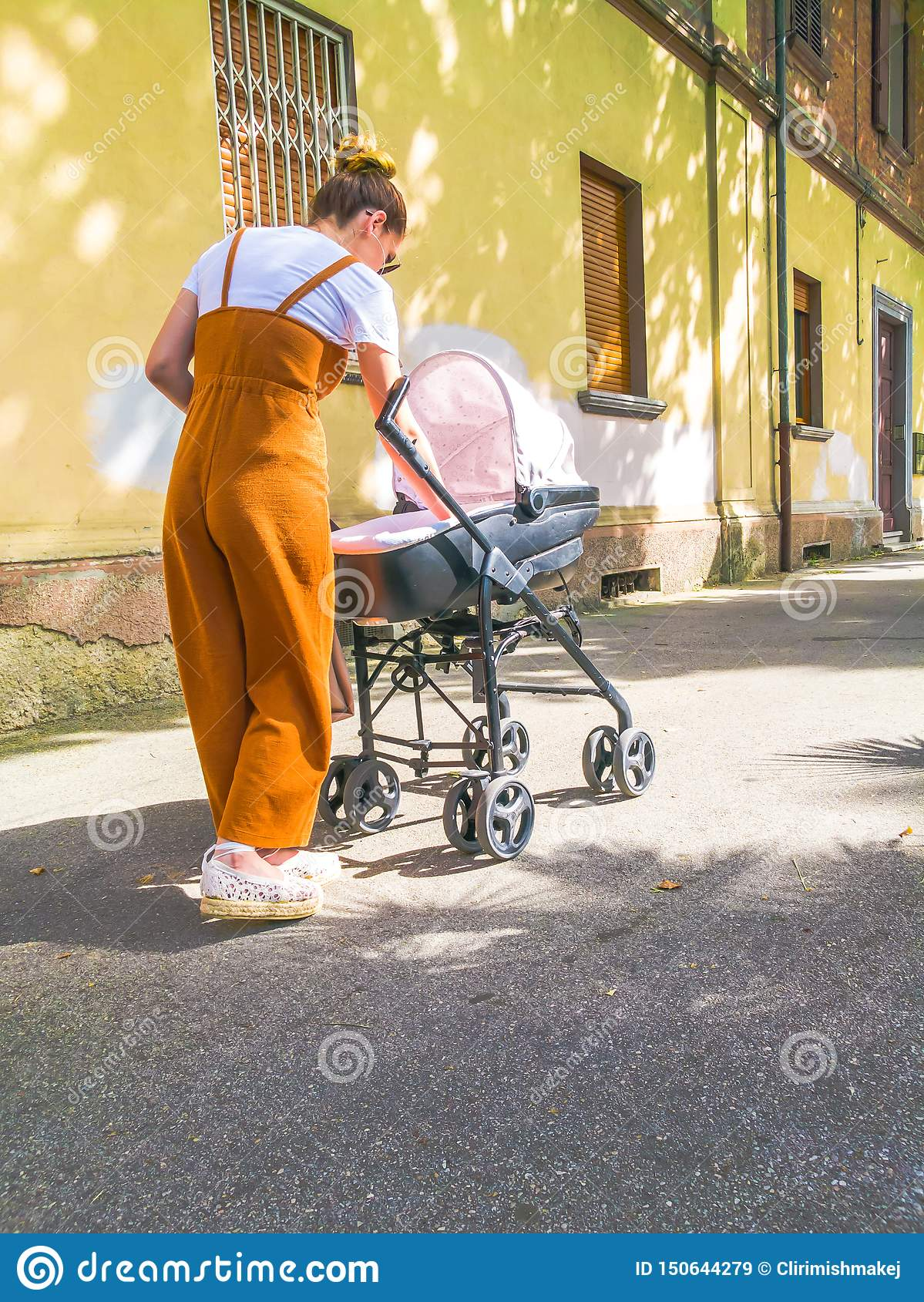 Mother with stroller in town.