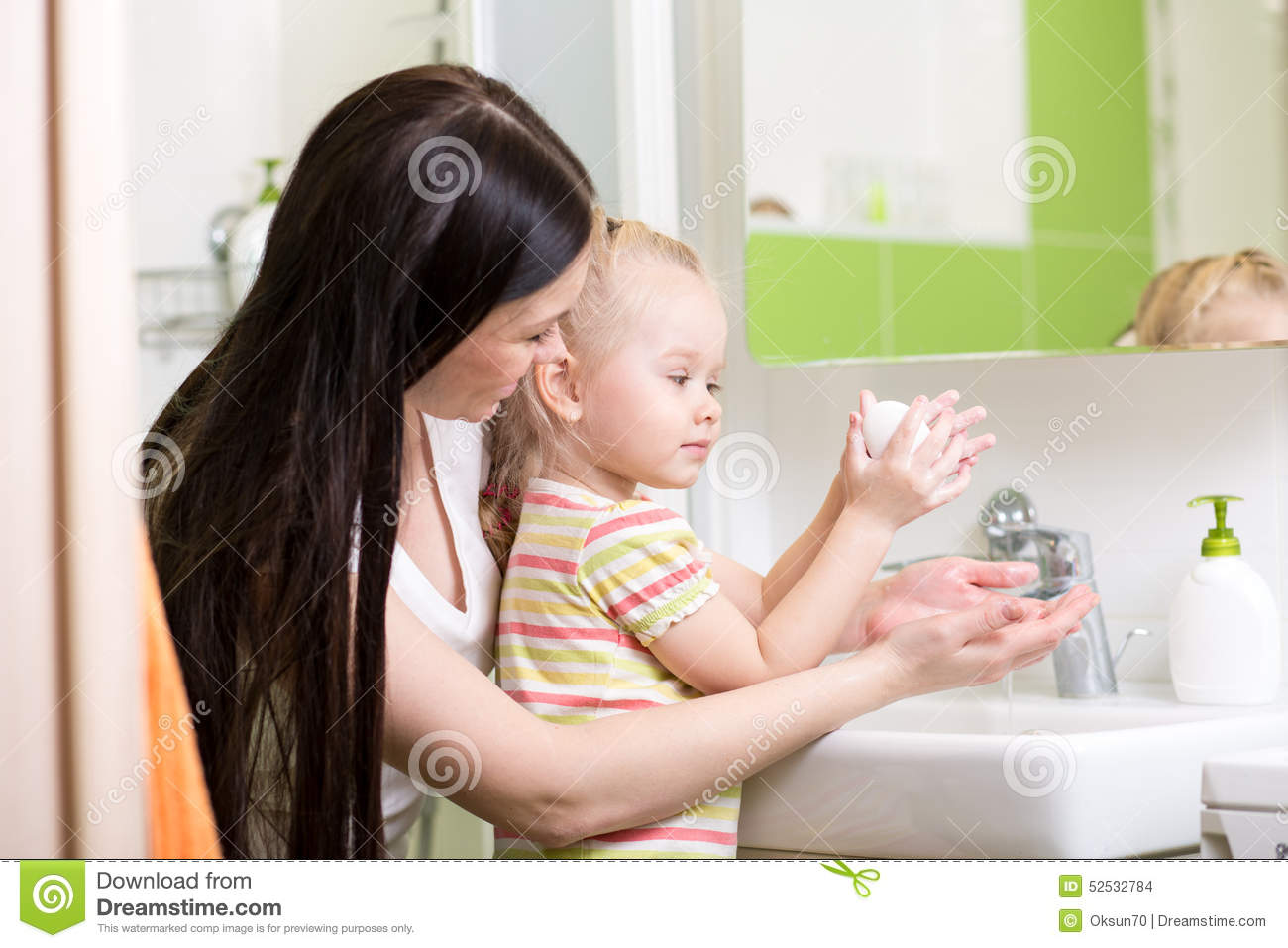 Mother Teaches Kid Washing Hands In Bathroom Stock Photo