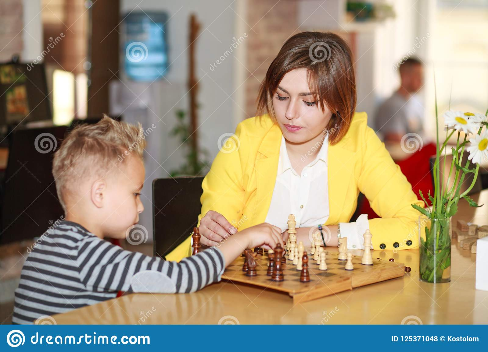 Mother teaches son play chess at home, parenting education