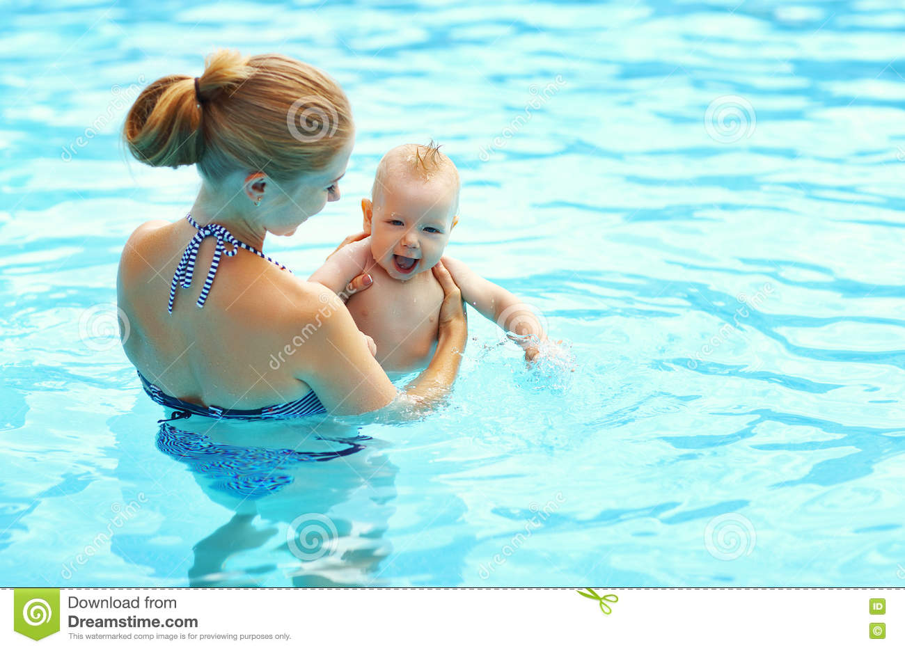 Mother teaching baby swimming pool