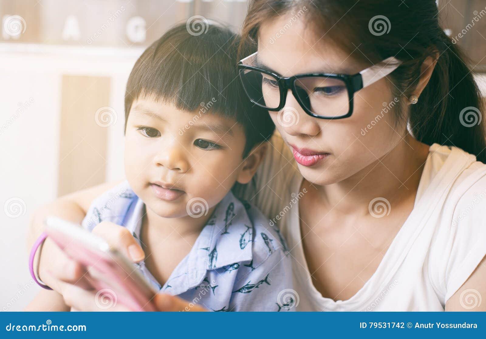 mother teaching a boy nak