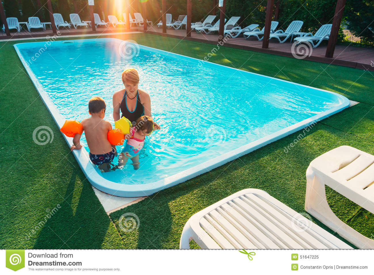 Mother teaching her children to swim stock photo image for Swimming pool poker