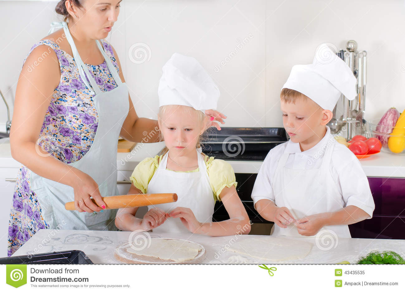 Mother Teaching Two Children To Bake Stock Image - Image of ...