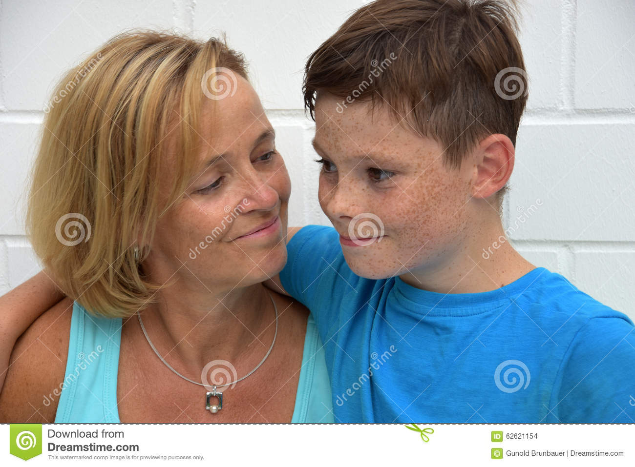 Mother And Teenager Son. Teenager Son Embracing His Mother Stock Images