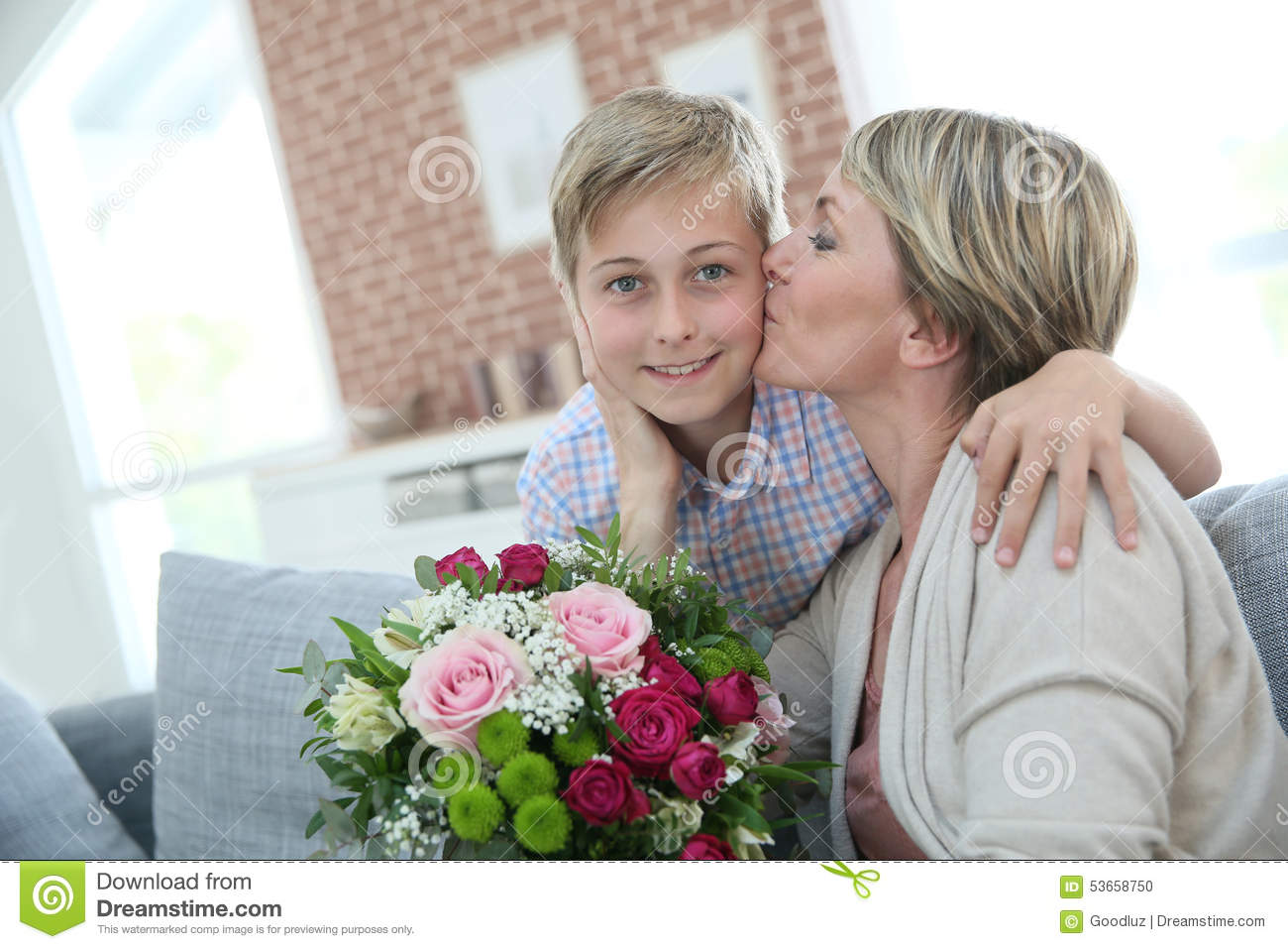Mother thanking and giving kiss to her son