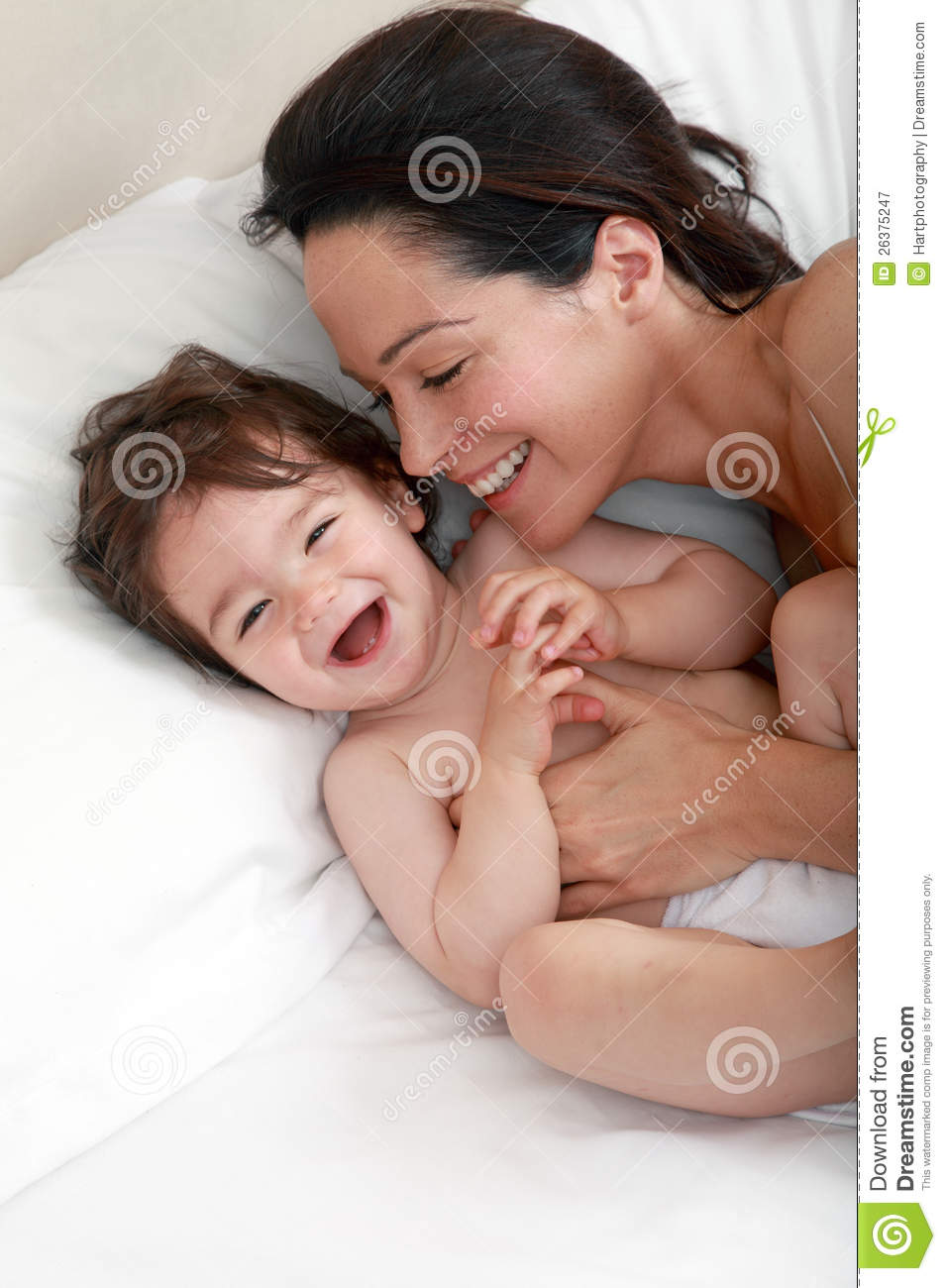 Mother tickling baby