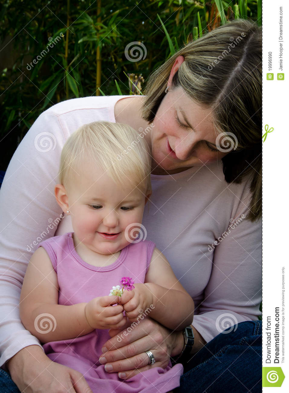 Mother and toddler holding flowers