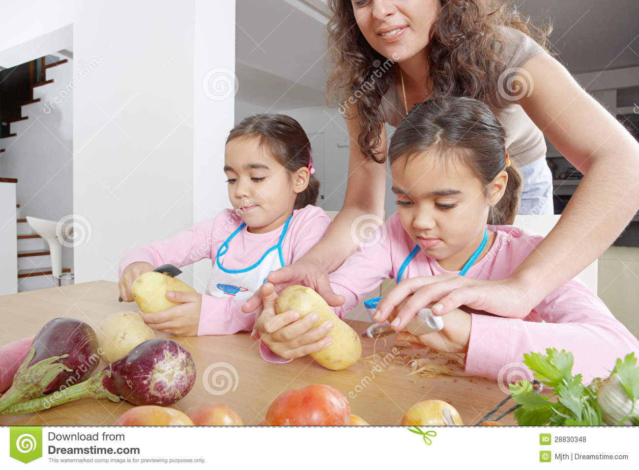 Mother And Twins Peeling Potatoes In Kitchen Royalty Free Stock Photos Image 28830348