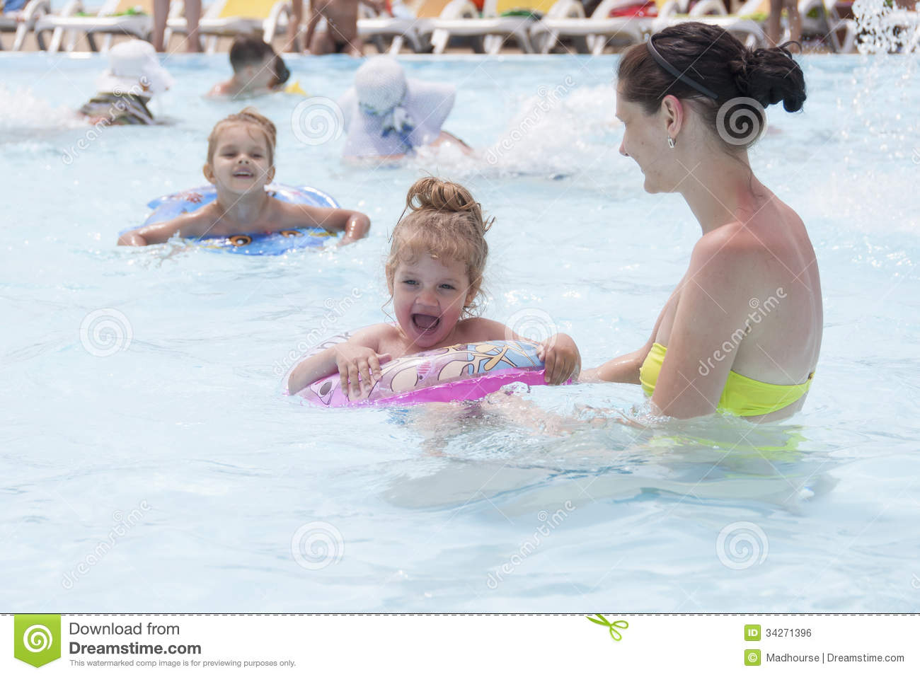 A Mother And Two Daughters Are Swimming In A Public Pool Royalty Free Stock Image Image 34271396