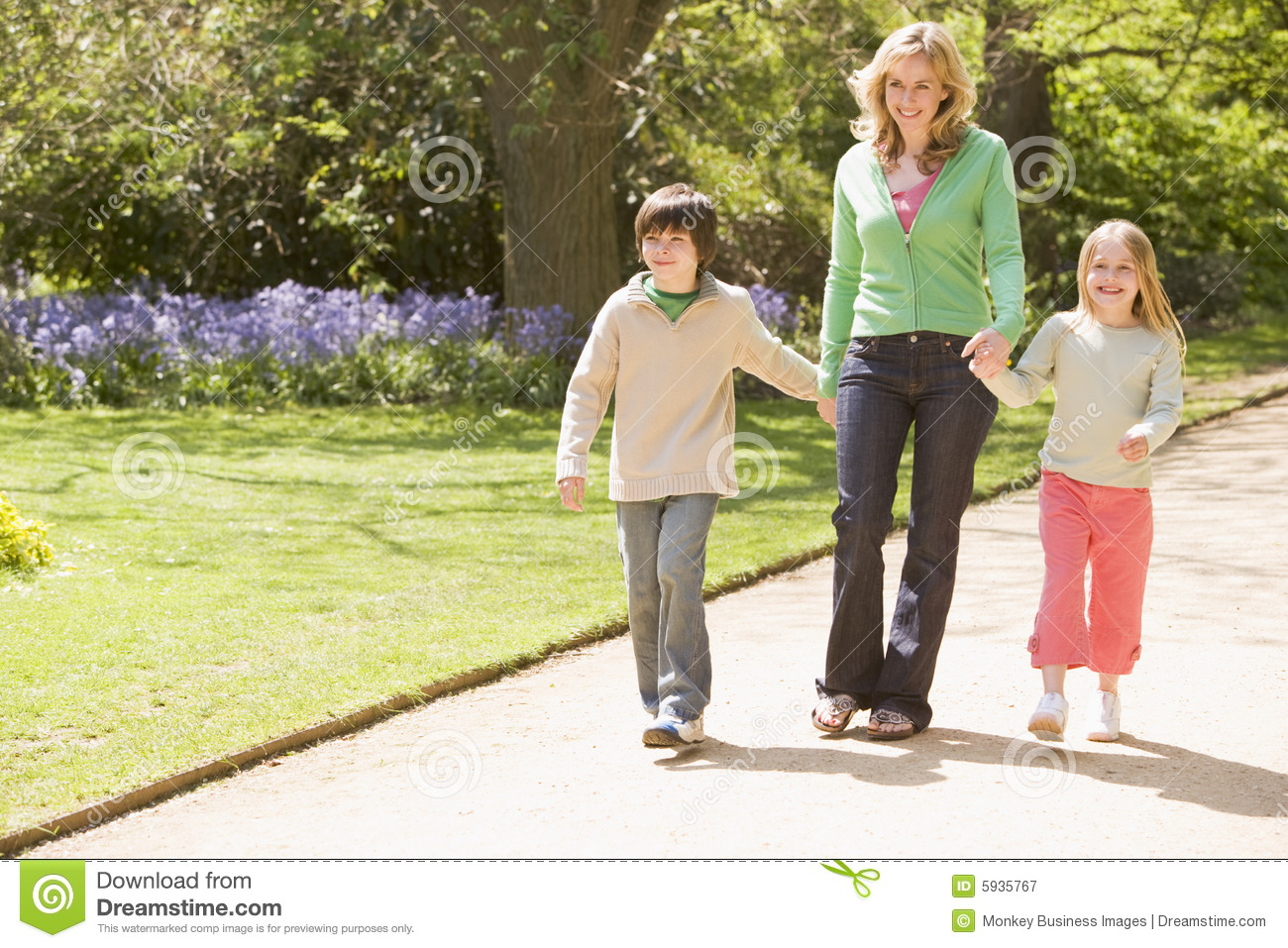 Mother And Two Young Children Walking On Path Stock Image ...