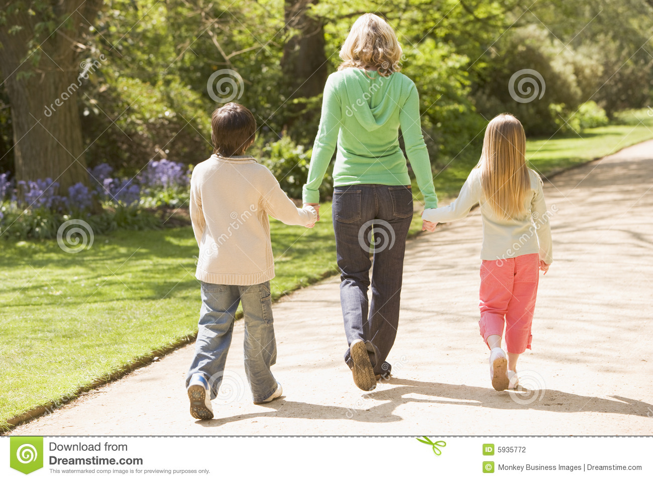 Mother And Two Young Children Walking On Path Stock Photo ...