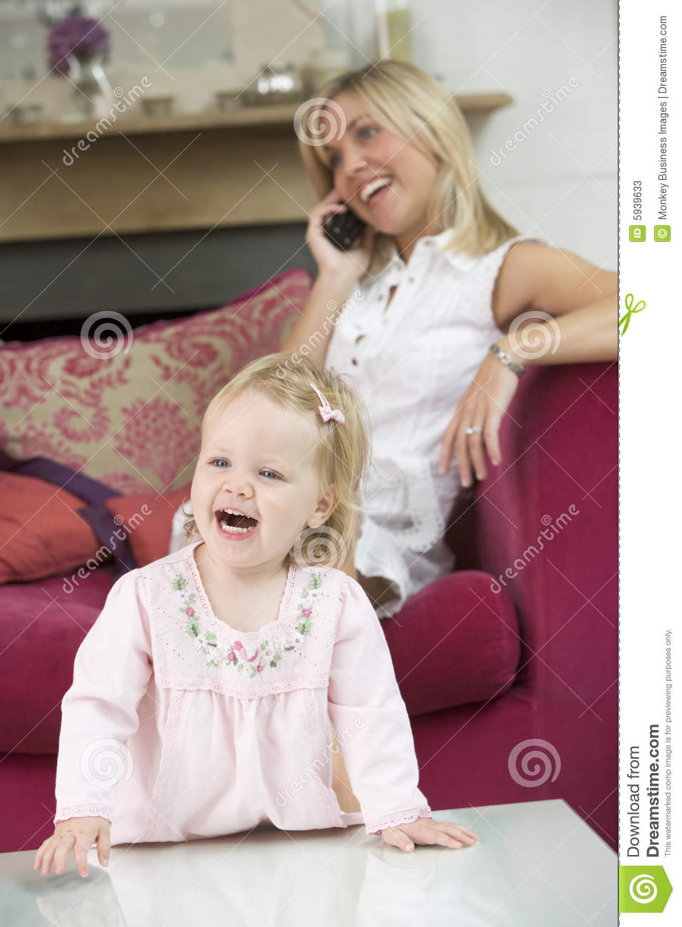 Mother Using Telephone In Living Room With Baby Stock ...