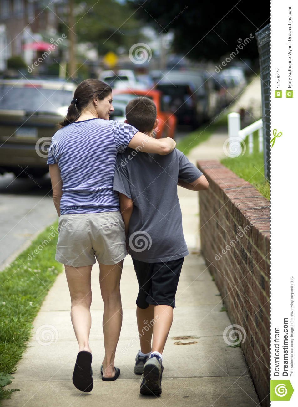 mother walking with son stock photography