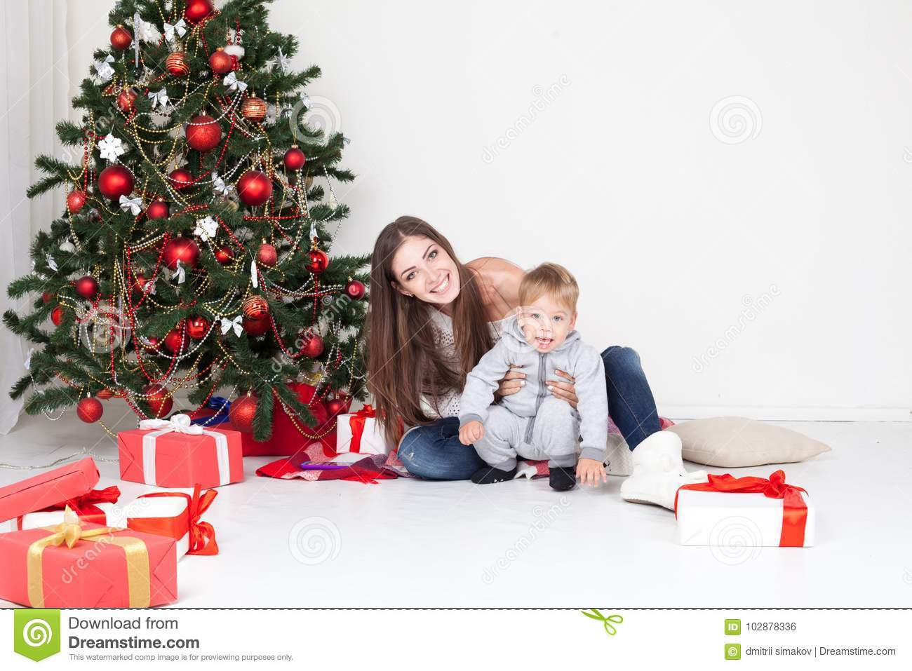 Mother And Son Open Gifts On Christmas And New Year Stock Photo ...