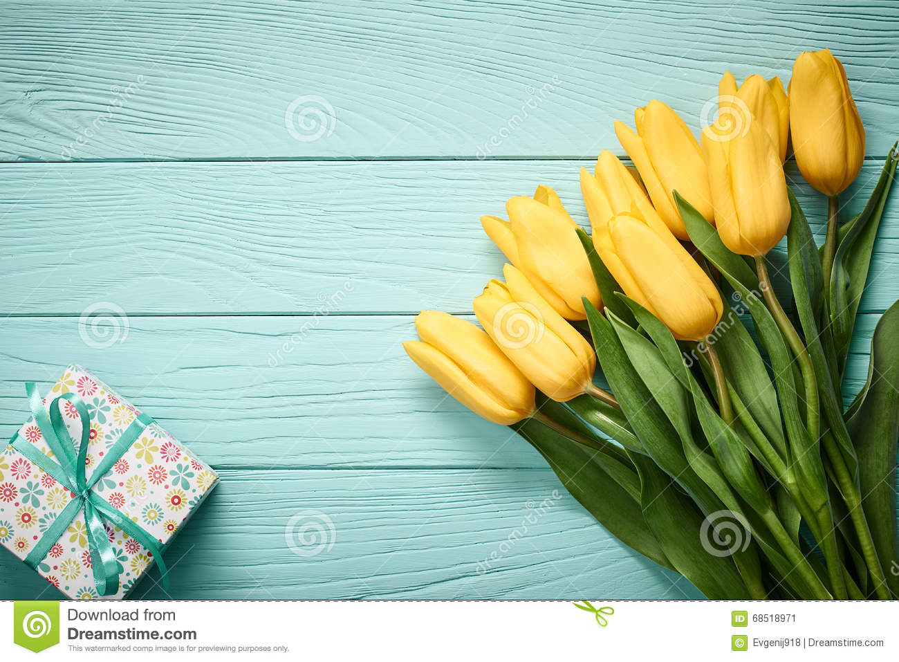 mothers day background  tulips  gift box on wood stock photo