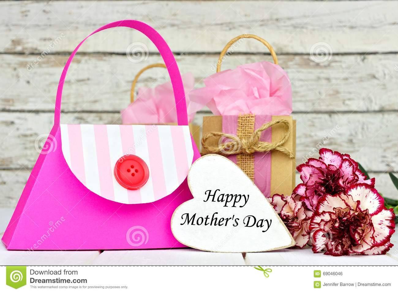Mothers day gift bags with heart tag and flowers stock