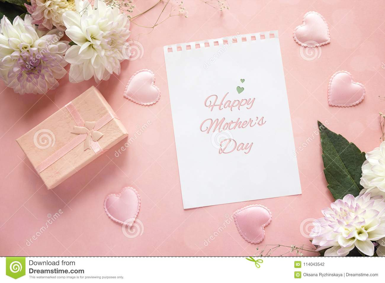 Mothers Day greeting message with dahlias and gift box on a pink