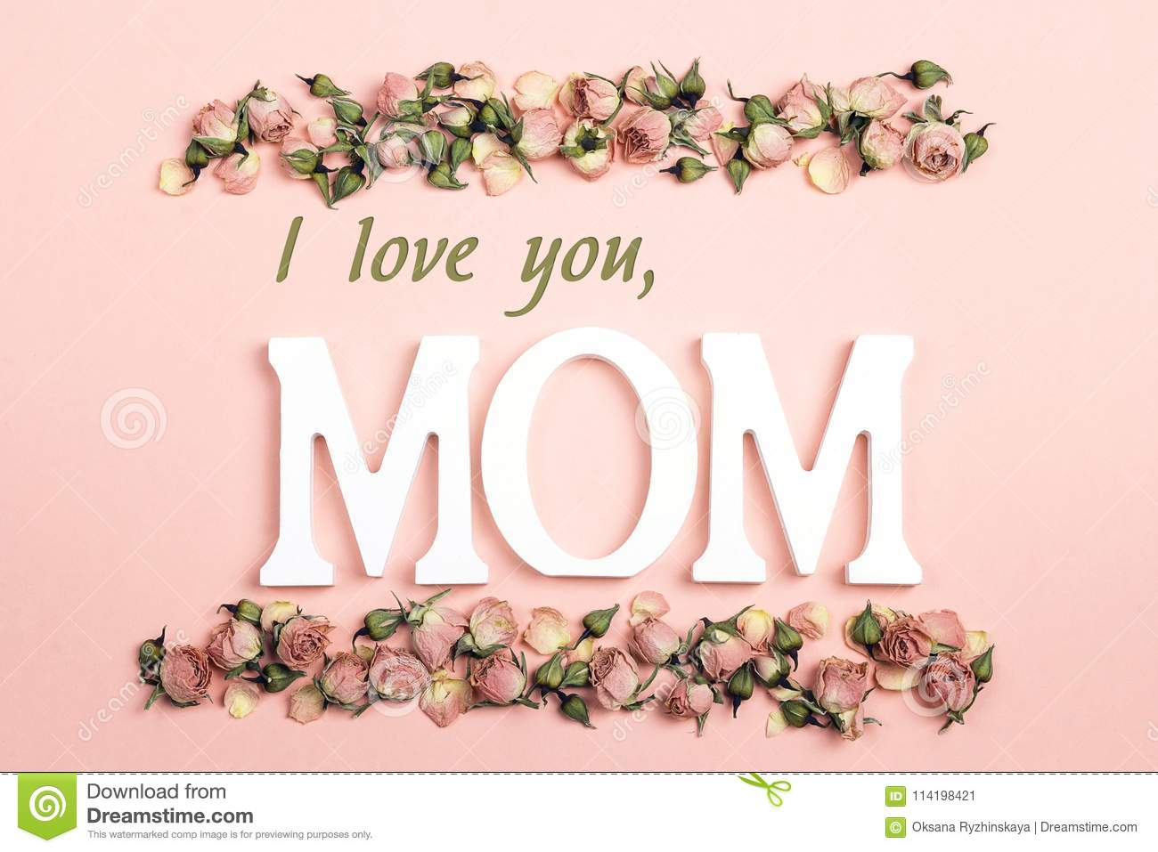 Mothers Day greeting message with small dry roses on pink background. Flat lay, top view.