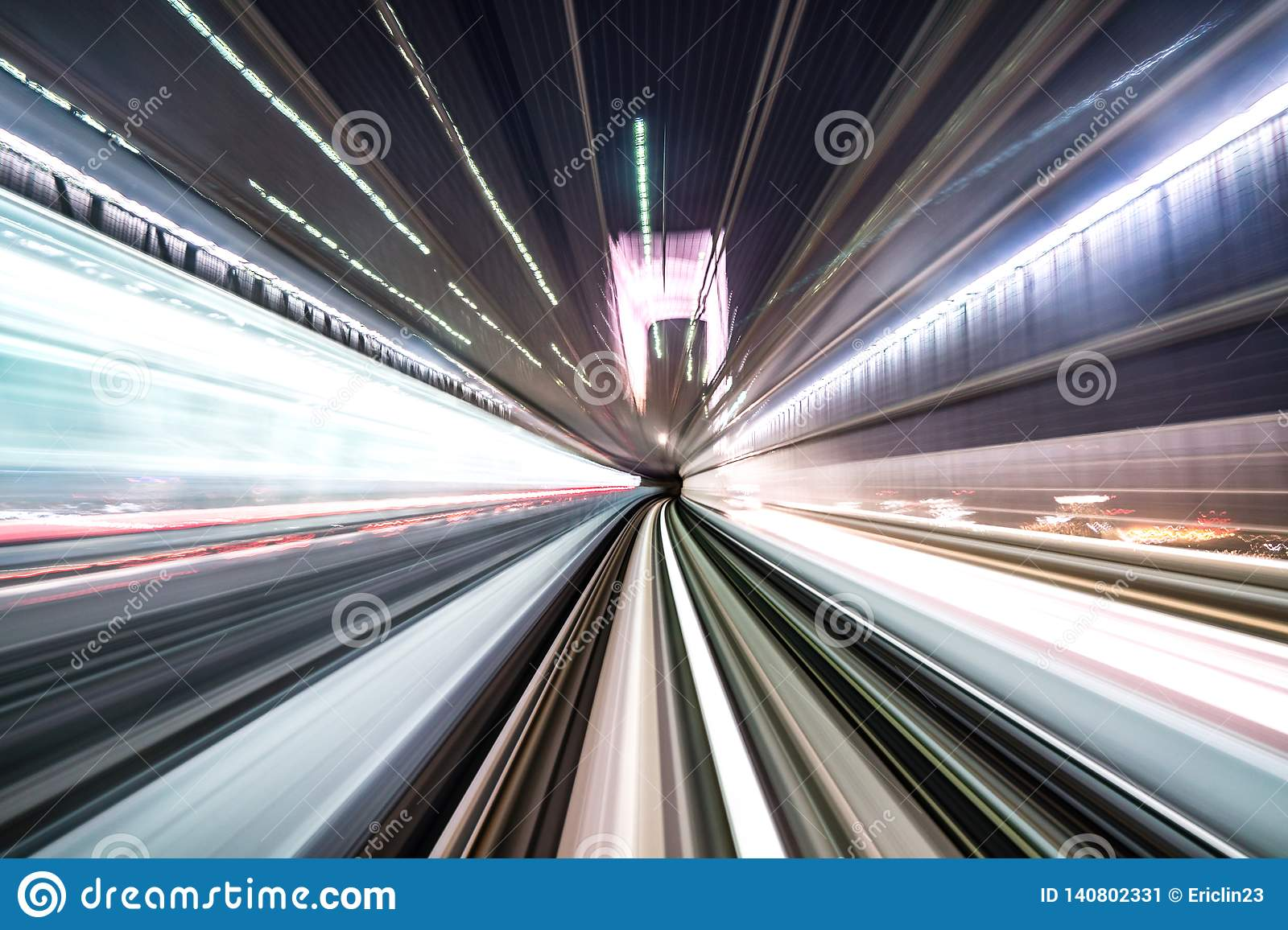Motion blur of train moving inside tunnel with daylight in tokyo, Japan