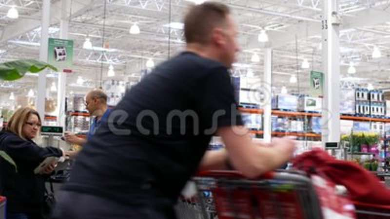 Motion Of Cashier Scanning Food And Stocking Them On Trolley At Check Out Counter Stock Footage