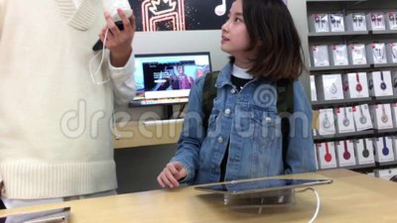 Motion of people playing new ipad pro inside Apple store