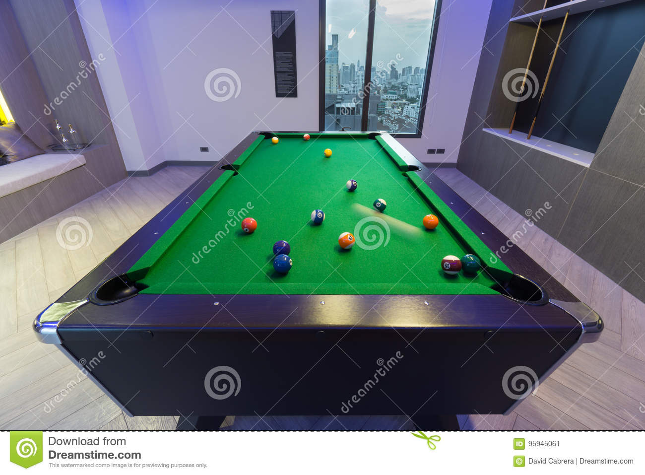 Motion Snooker Pool Billiards green table with complete set of balls in a middle of a game in a modern games room