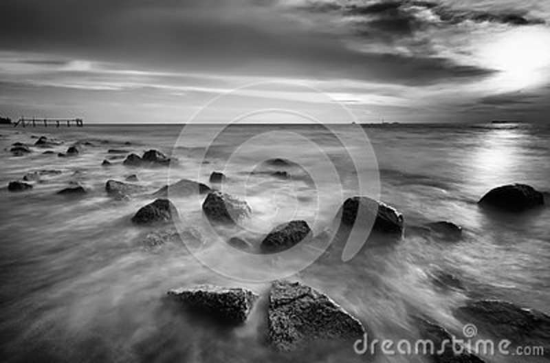 Motion waves on stones at the beach.