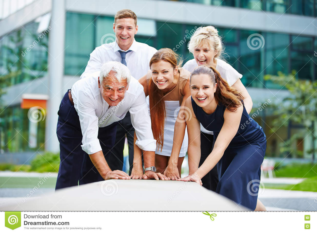 Motivated business team working together
