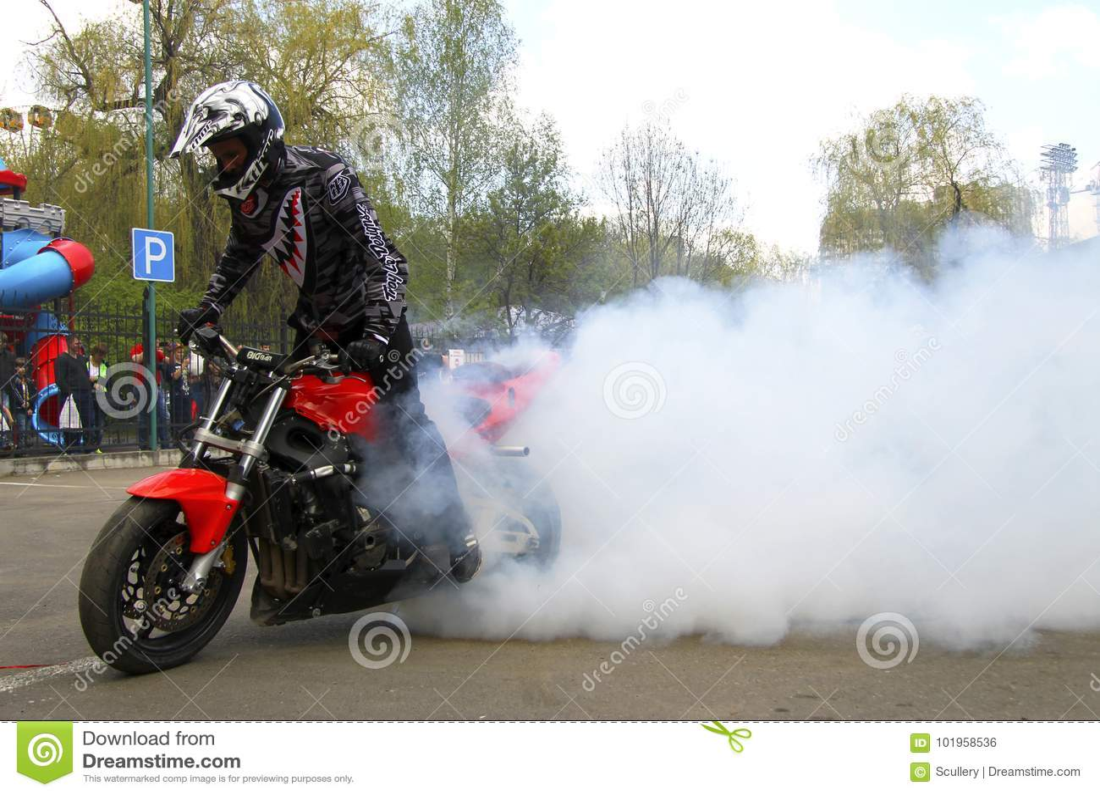 Motofree moto free style pilot stunting on the square editorial photo - image