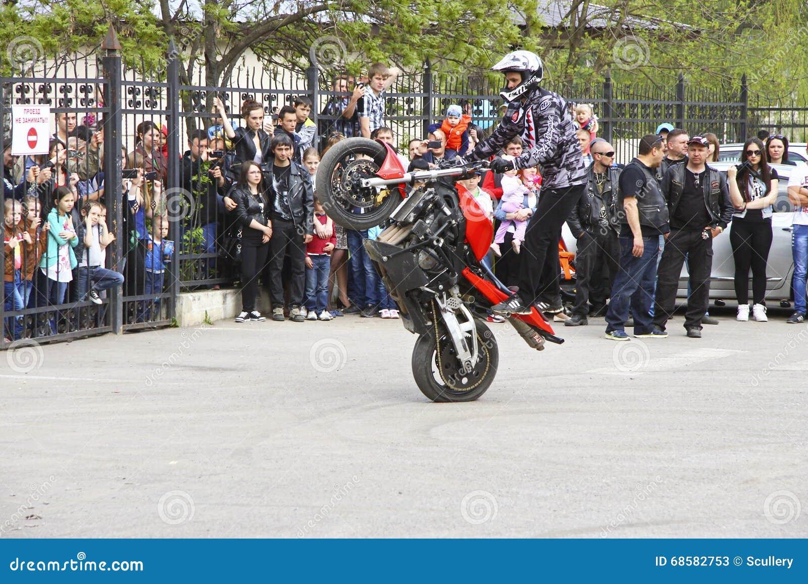 Motofree moto free style pilot stunting on the square editorial stock photo