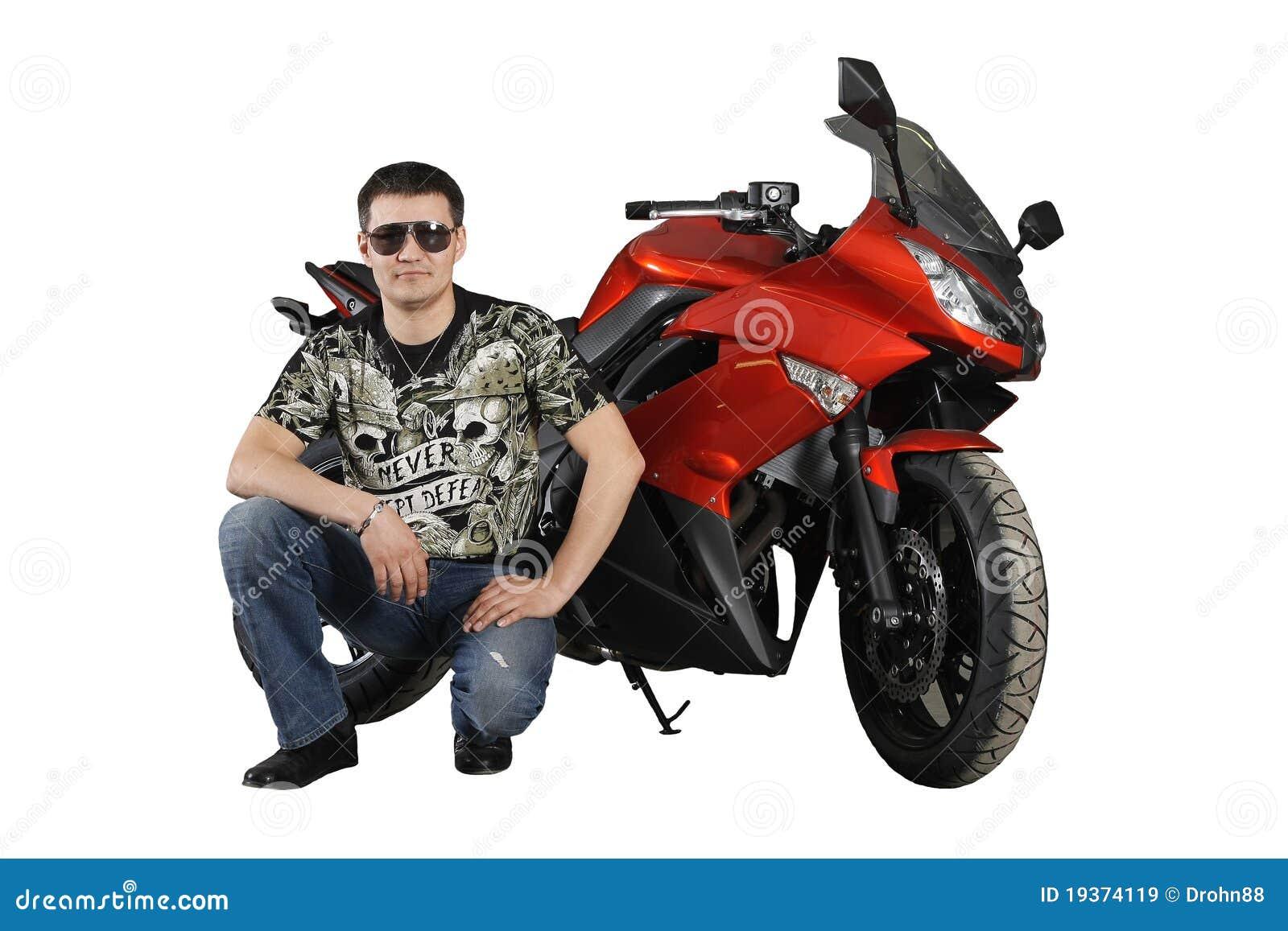 Motociclista com motocicleta vermelha