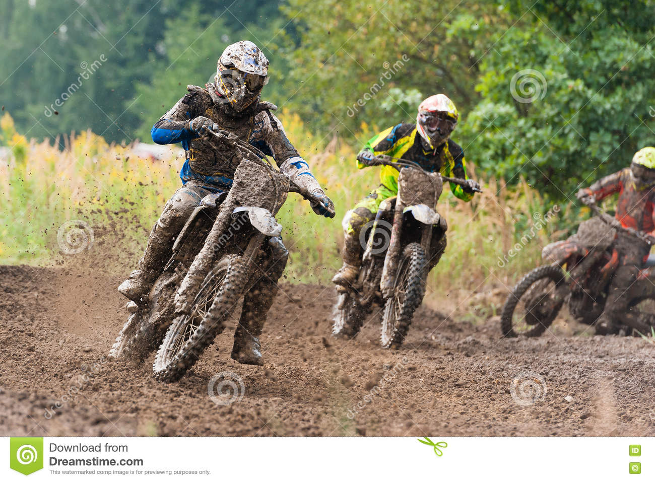 Close Up Of A Dirt Bike And Rider In A Mud Puddle. Stock