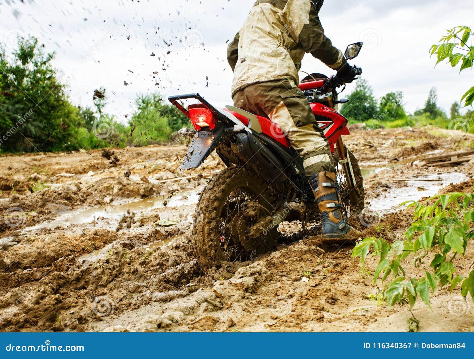 Motocross Rider Plowing Through Mud Stock Image - Image of