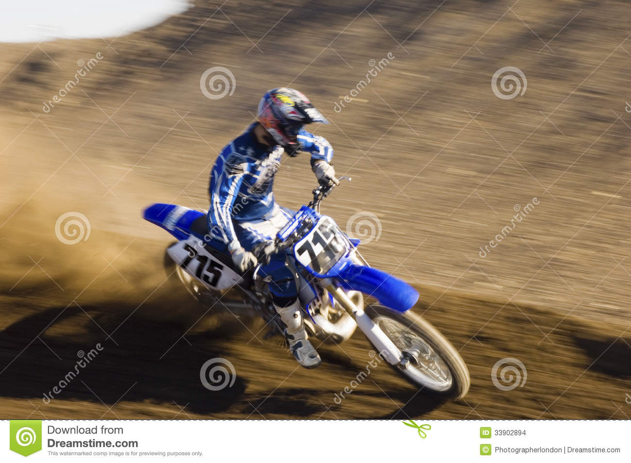 Motocross Racer Riding Motorcycle On Dirt Track