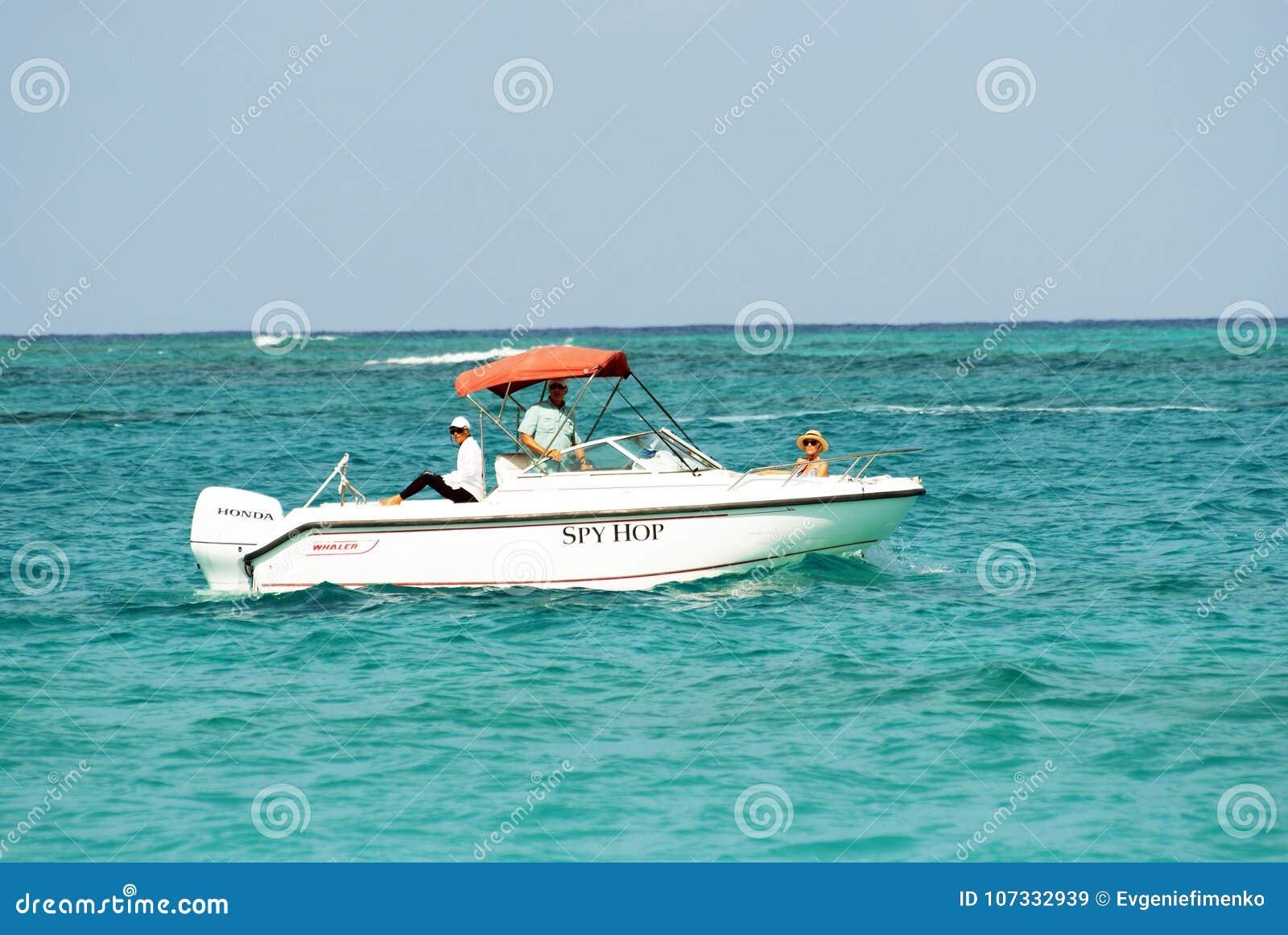 Motor boat cruising in ocean with passengers