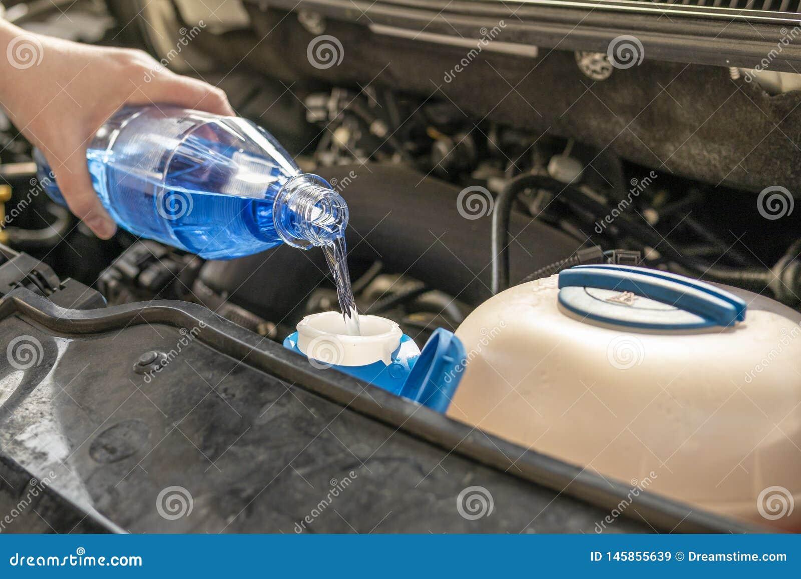 Motor check refill wash fluid